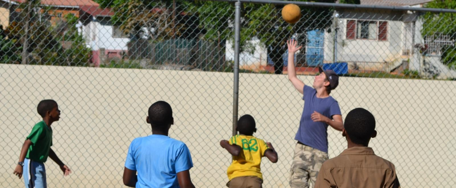 Students learn the basics of basketball during volunteer sports coaching in schools in Jamaica